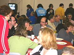 adults enjoying food and friends at Superbowl Party