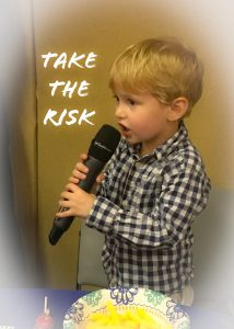 toddler singing into microphone at early shabbat service